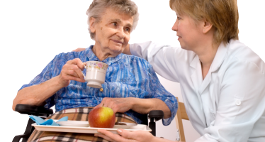 woman assisting an old lady while eating